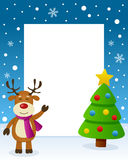 Christmas Tree Frame - Cute Reindeer. Christmas vertical photo frame with a Christmas tree and a happy reindeer smiling in a snowy scene. Eps file available Royalty Free Stock Photo