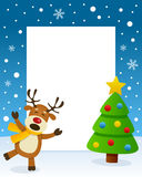 Christmas Tree Frame with Happy Reindeer. Christmas vertical photo frame with a Christmas tree and a happy reindeer singing in a snowy scene. Eps file available Royalty Free Stock Images