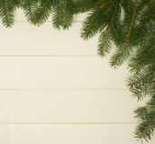 Christmas tree framework branches on wooden background with copy space. Horizontal template for design. Christmas tree framework branches on wooden background royalty free stock photo
