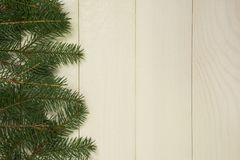 Christmas tree framework branches on wooden background with copy space. Horizontal template for design. Christmas tree framework branches on wooden background stock images