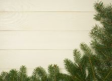 Christmas tree framework branches on wooden background with copy space. Horizontal template for design. Christmas tree framework branches on wooden background royalty free stock photos