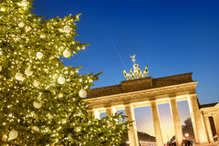 Christmas tree in front of Brandenburg gate in the evening Stock Images
