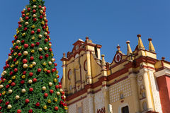 Christmas tree in front of church Royalty Free Stock Image