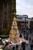 Christmas tree in front of St Martin`s Church, Birmingham city centre, United Kingdom, in December 2017. Artificial Christmas tree with the star on the top and stock photos
