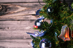 Christmas Tree. In front of a wooden background Stock Image