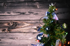 Christmas Tree. In front of a wooden background Stock Images