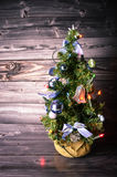 Christmas Tree. In front of a wooden background Royalty Free Stock Photography
