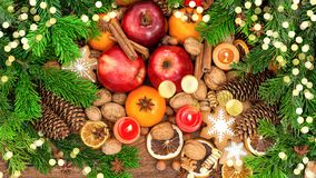 Christmas tree fruits cookies golden lights Food background stock image