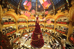 The Christmas tree at Galeries Lafayette. PARIS - DECEMBER 30: The Christmas tree at Galeries Lafayette, trade pavilions with perfume, view from the upper stock images