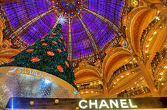 Christmas Tree in Galeries Lafayette, Paris. Paris,France- December 18, 2012: Upper part of the Chanel stand and the beautiful decorated Christmas tree in Stock Image