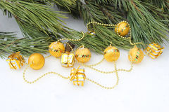 Christmas tree garland golden balls. On snow background Stock Image