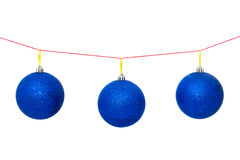 Christmas tree garland with New Year`s or Christmas balls. New Year`s or Christmas balls are suspended on the rope Stock Photography