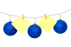 Christmas tree garland with notes, New Year`s or Christmas balls. New Year`s or Christmas balls are suspended together with notes on the rope Royalty Free Stock Photo