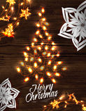 Christmas tree garland poster. With lettering Merry Christmas and happy new year in a retro style with decorations in garlands gloving and paper snowflakes on Royalty Free Stock Photography