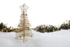 Christmas tree and garland in the snow Stock Image