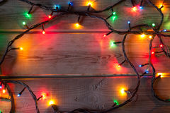 Christmas tree garland on wooden table Stock Photos