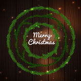Christmas tree garlands. Beautiful illustration of green bushy christmas garlands with shiny lights on dark wooden background. Editable decorative elements for Royalty Free Stock Image