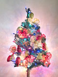 Christmas tree with garlands and lights on. Christmas tree with decorations and lights on Royalty Free Stock Images