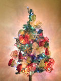 Christmas tree with garlands and lights on. Christmas tree with decorations and lights on Stock Photography