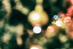 Christmas tree with garlands in out of focus Royalty Free Stock Photo