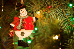 Christmas-tree, garlands and snowman decoration Stock Image