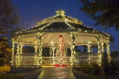 Christmas Tree and Gazebo. Gazebo in a city park at Christmas time, with a Christmas tree inside royalty free stock photos