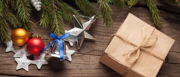 Christmas tree with gift box and decorations on wooden backgroun. D space for lettering stock images