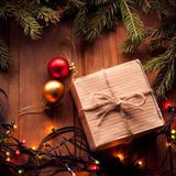Christmas tree with gift box and decorations on wooden backgroun. D space for lettering stock photography