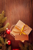 Christmas tree with gift box and decorations on wooden backgroun Stock Photos