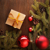 Christmas tree with gift box and decorations on wooden backgroun Stock Photo