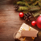 Christmas tree with gift box and decorations on wooden backgroun Royalty Free Stock Photos