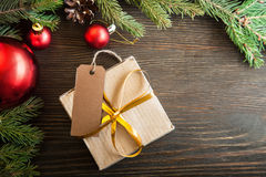 Christmas tree with gift box and decorations on wooden backgroun Royalty Free Stock Images