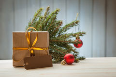 Christmas tree with gift box and decorations on wooden backgroun Stock Images