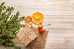 Christmas tree with gift box and decorations on wooden backgroun Royalty Free Stock Image