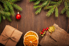 Christmas tree with gift box and decorations on wooden backgroun Stock Image