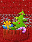 Christmas tree, gift, candy cane in knitted pocket Stock Photography
