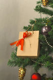 Christmas tree with gift. Closeup Stock Photo