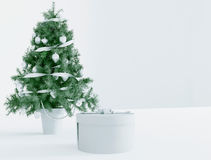 Christmas tree and a gift, 3d Royalty Free Stock Image