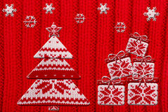 Christmas tree and gift shapes cut from knitted pattern Royalty Free Stock Images