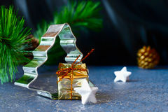 Christmas tree with the gift, stars and pine cone Stock Images