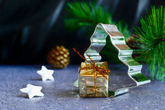Christmas tree with the gift, stars and pine cone Royalty Free Stock Photo