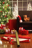 Christmas tree with gifts. And teddy bear on chair Royalty Free Stock Image