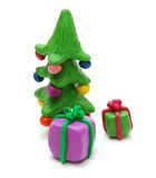 Christmas Tree and Gifts. 3D Gifts and Christmas Tree Made of Colored Plasticine Isolated on White Background Stock Photo