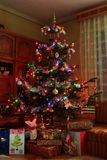 Christmas tree and gifts. With colorful lights stock image