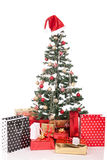 Christmas Tree and Gifts. Over white background Royalty Free Stock Image