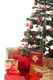 Christmas Tree and Gifts. Over white background Royalty Free Stock Photo
