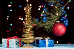 Christmas tree with gifts. And ball Royalty Free Stock Image