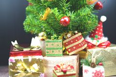 Christmas Tree with Gifts, on black background royalty free stock photo
