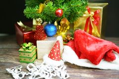 Christmas Tree with Gifts, on black background stock image