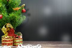 Christmas Tree with Gifts, on black background royalty free stock images